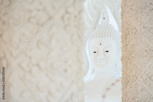 White Buddha statue in Church of Huai Pla Kung Temple.Chiang Rai, Thailand. © bubbers