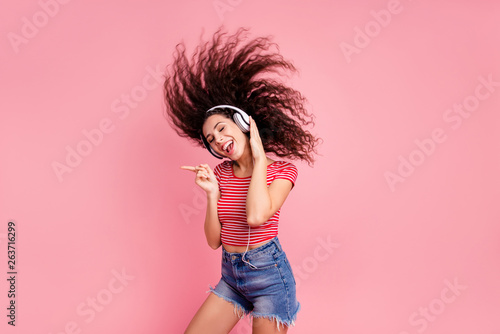 Portrait of her she nice-looking attractive cool lovely charming shine cheerful cheery glad wavy-haired girl meloman having fun time melody sound isolated over pink pastel background