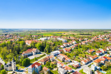 Croatia, Slavonia, town of Daruvar, main square and catholic church in spring, panoramic drone view