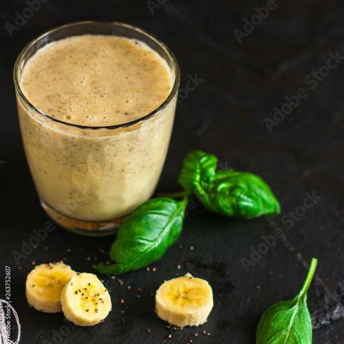 Smoothies, banana, basil, spinach, chia seeds and more are healthy food concepts. food background. top view © Alesia Berlezova