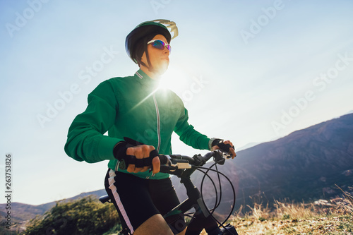 Man ride mountain bike on the road  Sport and active life concept