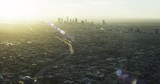 Sunset over Los Angeles skyline, wide aerial