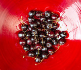 dark cherrys in a red bowl