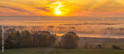 spring, misty sunrise over the valley