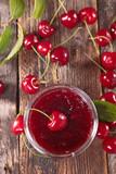 cherry jam on wood background