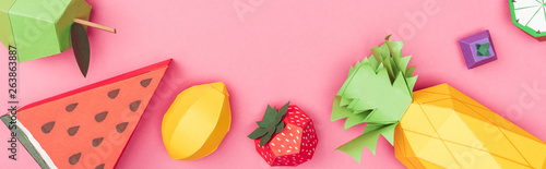 panoramic shot of multicolored handmade paper fruits isolated on pink