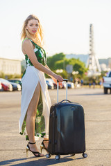 Fashion model traveling to new city