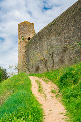 walking path along the city walls in Monteriggioni, Tuscany, Italy © Corinne