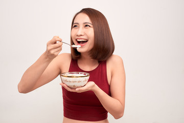 Woman in gym eating healthy after exercise