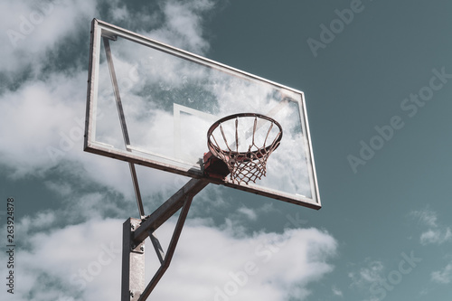 Basketball hoop against cloudy sky © graja
