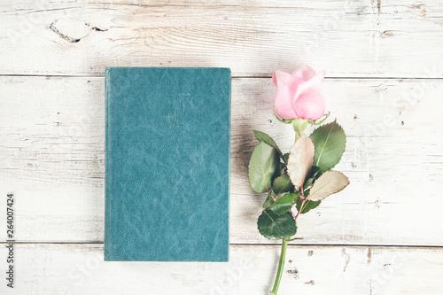 pink roses on blue  book on desk