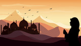 Panorama landscape Silhouette of one women praying in the desert background during the month of ramadan, Muslim woman praying during sunset with mosque background, Concept of the Islamic religion