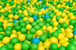 Green, yellow and blue balls in the playground