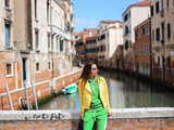 girl on Venice street with canal background. and streets
