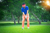 Golfer playing golf in beautiful golf course in the evening golf course with sunshine in thailand