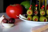 appetizer with olives, tomato, avocado, garlic and lard