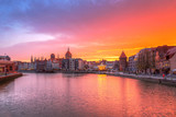 Amazing sunset in Gdansk reflected in Motlawa river, Poland.