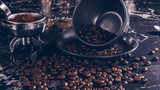 Coffee cup and beans on marble table