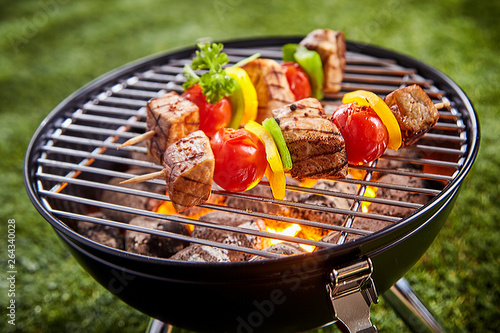 Assorted grilled meat with vegetable on a grill © exclusive-design