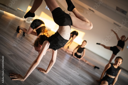 Group of young girls practicing and exercising modern ballet dance. © nd3000