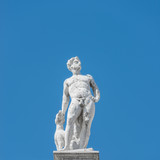 Statue as roof decoration of Doge's Palace in Venice, Italy
