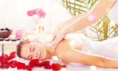 Beautiful young woman relaxing with massage at beauty spa © BillionPhotos.com