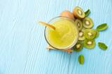 kiwi juice with lime on blue wood background