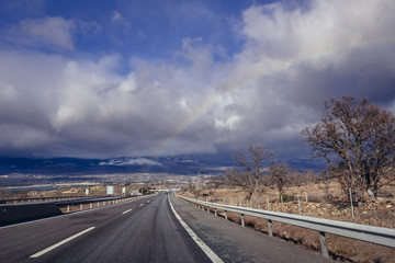 Rainbow over A1 motorway, one of the main roads in Spain © Fotokon