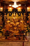 Golden Buddha statue at Bangplee Temple, Luang Pho To Temple, Thailand The beauty of temples and Buddha images of Thai religious art