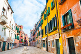 Beautiful street with old colorful architecture in Venice, Italy.