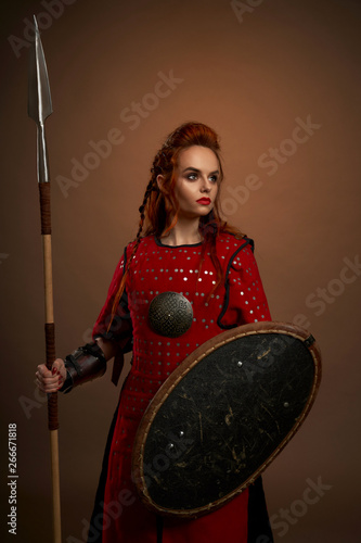 Female warrior keeping spear and shield and posing | Buy Photos | AP